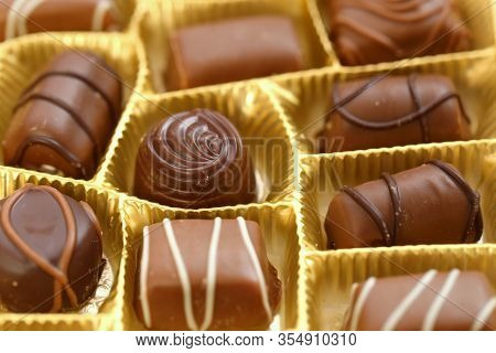 Chocolate Candy Close-up.assorted Chocolate Sweets.chocolate Candies Set In An Open Box. .sweet Dess