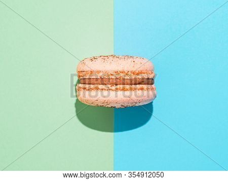 Pink Macaron On Two Colors Paper Background Perfect French Macarons Or Macaroons On Blue And Green B
