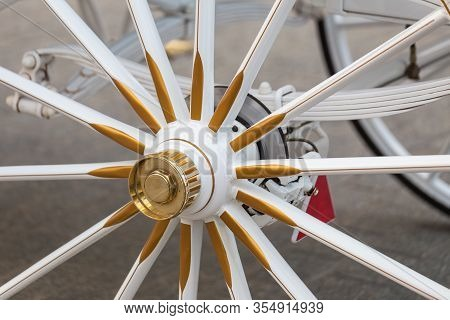 Wheel Of Horse-drawn Carriage In Close-up View.
