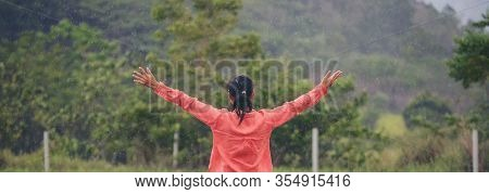 Let It Go Freedom Hand And Release Concept.lifestyle Of Young Girl Spread Hand Against Green Field B