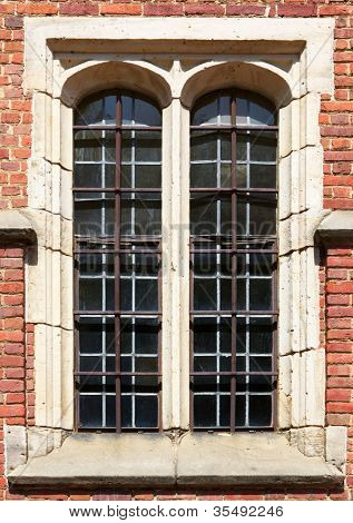 Pair of old church mult-paned windows with security bars