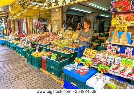 Tokyo, Japan - April 18, 2017: Vendor In One Of The Stalls Selling Fresh Fruit And Fish At Ameya-yok