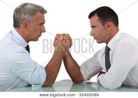 businessmen arm wrestling