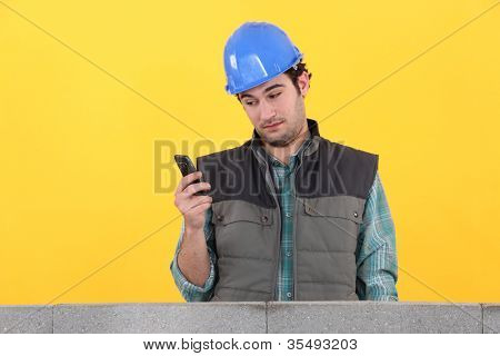 Worker behind wall