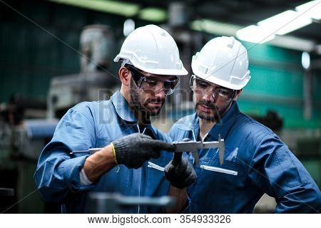 Two Maintenance Engineers Discuss Inspect Relay Checking Information And Protection System On A Tabl