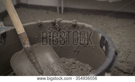Laying Mortar. Mortar In A Bucket. Fresh Mixing Of Concrete In A Bucket At A Construction Site