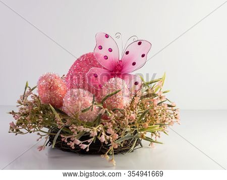 Pink Butterfly Sitting In A Giant Pink Easter Egg With Smaller Pink Easter Eggs On A Pink Spring Wre