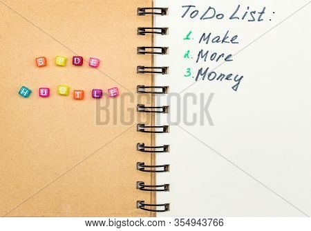 Side Hustle Words Made Form Multicolored Square Beads On Spiral Notebook Cover. Concept Image Of Pas