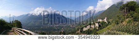 Panoramic View Of The Adige Valley And Castle Tyrol In South Tyrol, Italy; Along The Adige River The