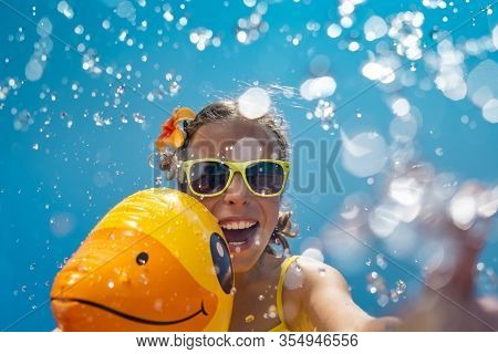Happy Child Having Fun On Summer Vacation