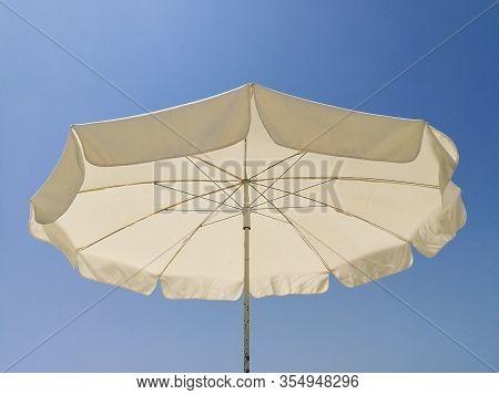 Wide Angle View Of Beach Umbrella Sunny Day