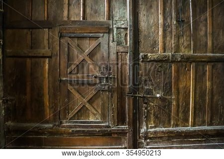 Ancient Wooden Door, Central Entrance To Church. Detail Of The Interior Of The Eglise Saint Etienne