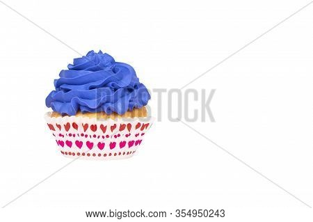 Cupcake With Blue Buttercream Frosting Isolated On White Background. Copy Space. Festive Banner.