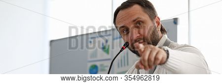 Portrait Of Serious Businessman Looking At Camera With Seriousness And Interest. Serious Man Pointin