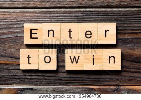 Enter To Win Word Written On Wood Block. Enter To Win Text On Wooden Table For Your Desing, Concept