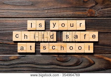 Is Your Child Safe At School Word Written On Wood Block. Is Your Child Safe At School Text On Wooden