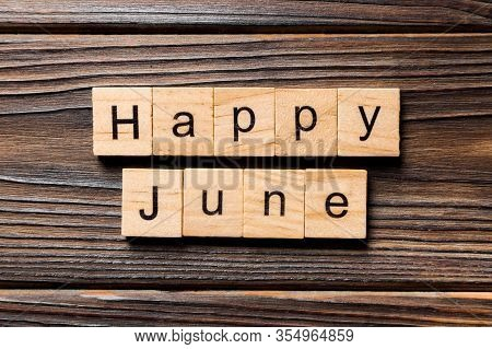 Happy June Word Written On Wood Block. Happy June Text On Table, Concept