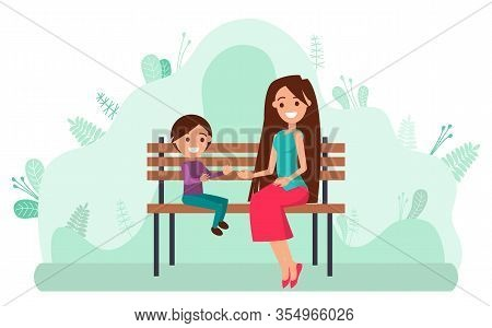 Mother With Little Daughter Sitting On Wooden Bench In Park. Young Woman And Child Smiling And Playi