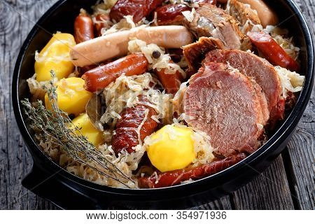 The Alsace Sauerkraut, Named Choucroute In French A Fermented Cabbage Stew With Pork Loin, Bacon, An