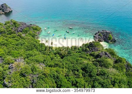 Rocky Island With A White Sandy Beach, Top View. Aerial Top View Of Ocean Waves, Beach And Rocky Coa