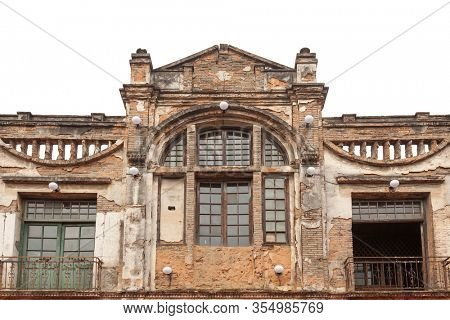 The facade of old abandoned building with broken and peeled wall and door and window in the traditional old style town,Fuzhou,Fujian,China