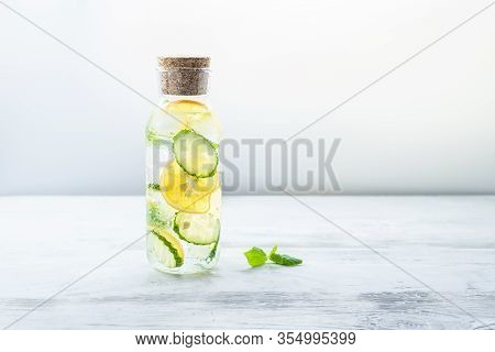 Detox Sassy Water With Lemon, Cucumber And Mint. A Glass Bottle Of Clean, Cool And Fresh Drink Stand
