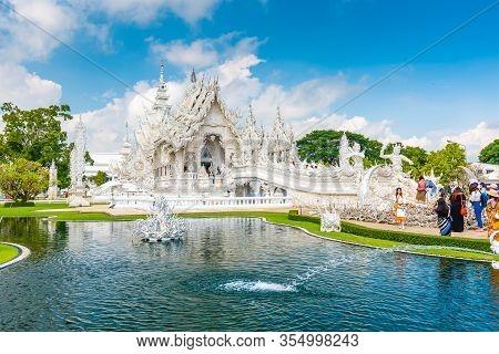 Chiang Rai, Thailand - 6.11.2019: Tourists Visit Famous White Temple (wat Rong Khun) Near Chiang Rai
