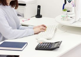 Secretary Woman Typing On Keyboard. Working At Office Concept. Young Womans Hands On Keyboard.