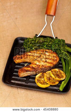 Salmon steak with broccolini