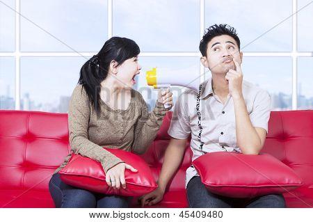 Girlfriend Shout Using Megaphone In Apartment