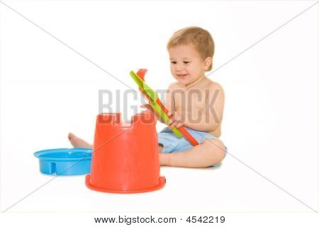 Lovely Baby Playing With Bucket And Shovel