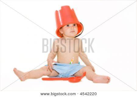 Joyful Baby With Beach Bucket On Head