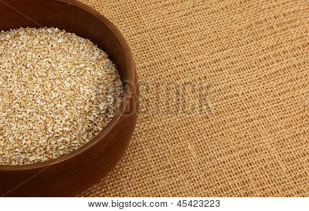 Bowl Of Steel Cut Oatmeal On Burlap Bag