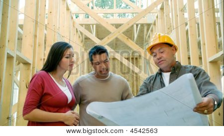 Couple Talking To Contractor