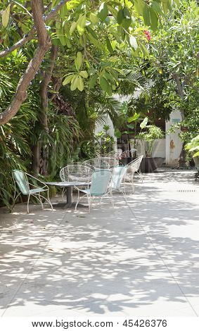 Shaded Patio Area With Wire Basket Chairs
