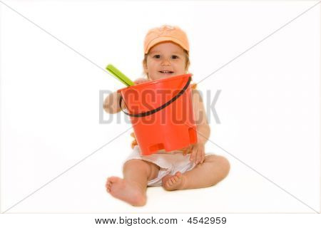 Happy Baby With A Beach Bucket