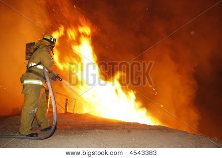 Firefighter Extinguishing Flames