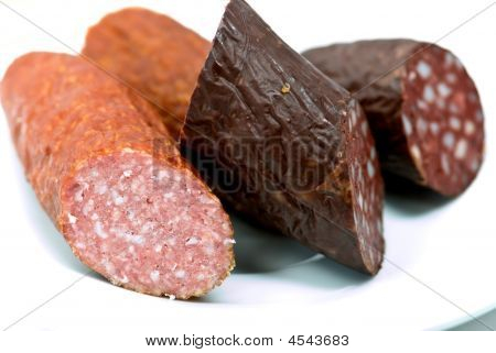 Mixed,tasty Sausages On The Plate- Close Up