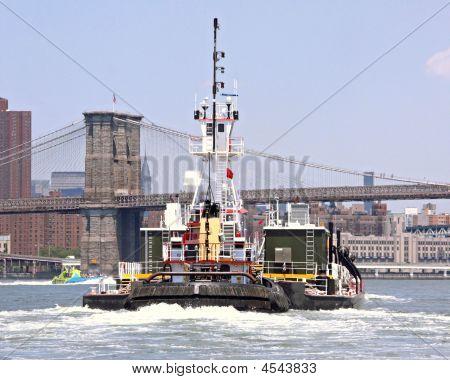 Tug And Brooklyn Bridge