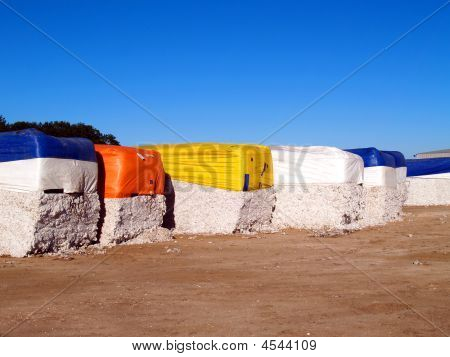 Cotton Modules Lined Up In A Gin Lot