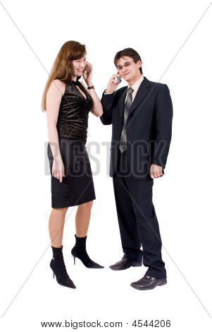 Young Couple Talking On The Phone Isolated On White