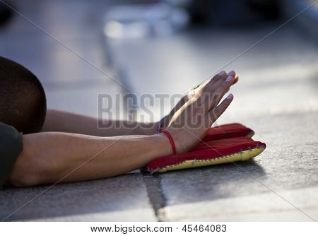 Tibetan pilgrim praying