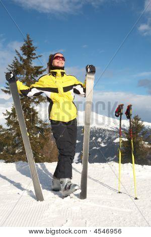 Girl With Ski In Mountain