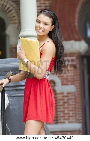 Beautiful Female Student Holding A Notebook