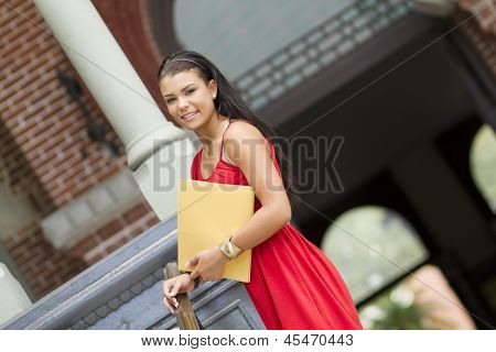 Happy Female Student At Entryway