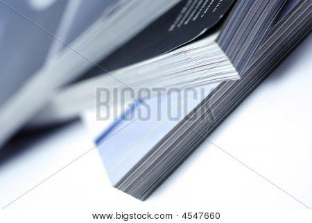 Stacked Magazines Isolated On White Background.