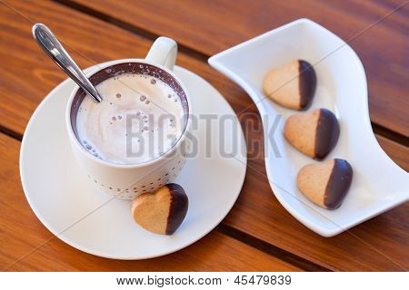 Chocolate Dipped Heart Shaped Shortbread Cookies And A Cup Of Cappuccino