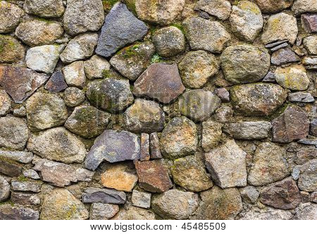 Wall Of Round And Crushed Stone With Moss