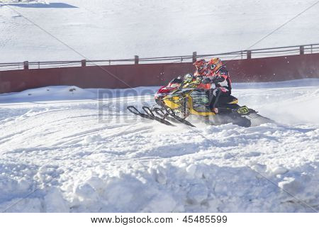 Two Snowmobiles Racing Neck And Neck