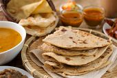 Chapati or Flat bread, roti canai, Indian food, made from wheat flour dough. Roti canai and curry. poster